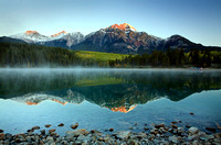 Pyramid Mountain reflects in Patricia Lake at Sunrise